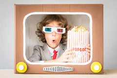 Child playing with cartoon TV Stock Image