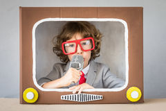 Child playing with cartoon TV Royalty Free Stock Photo