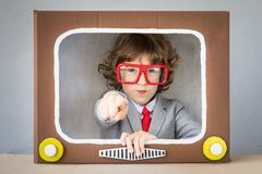 Child playing with cartoon TV Stock Images