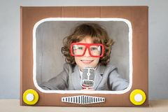 Child playing with cartoon TV Stock Photo