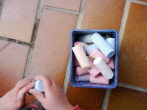 Child playing with chalk Royalty Free Stock Images