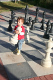 Child playing chess Royalty Free Stock Image
