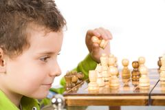 Child playing chess Stock Photo