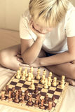 Child playing chess Royalty Free Stock Images