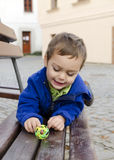 Child playing on city bench Stock Photos