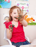 Child  playing with  clay in play room. Royalty Free Stock Photo