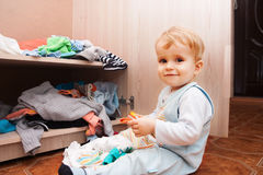 Child playing with clothes Royalty Free Stock Photos
