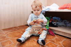 Child playing with clothes Royalty Free Stock Photography