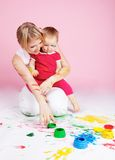 Child playing with color paints Royalty Free Stock Photo