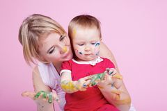 Child playing with color paints Royalty Free Stock Images