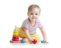 Child playing with color pyramid toy Stock Photos