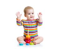 Child playing with color pyramid toy Stock Photo