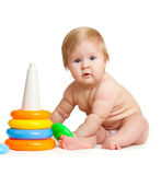 Child playing with color pyramidion. Child playing with color toy Royalty Free Stock Images