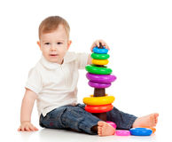 Child playing with color toy pyramidion. Child playing with color toy Royalty Free Stock Images