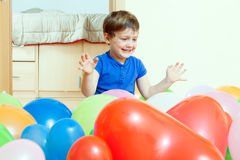 Child playing with colorful balloons Royalty Free Stock Photography