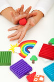 Child playing with colorful clay - closeup on hands Royalty Free Stock Images