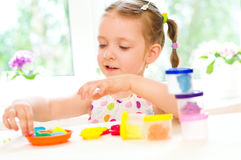 Child is playing with colorful dough Stock Photos