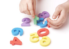 Child playing with colorful numbers Stock Photo