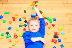 Child playing with colorful plastic blocks indoor Stock Photos