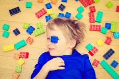 Child playing with colorful plastic blocks indoor Royalty Free Stock Photos