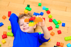 Child playing with colorful plastic blocks Royalty Free Stock Photos