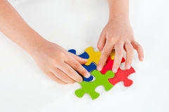 Child Playing Colorful Puzzle Stock Photography