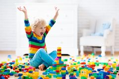 Child playing with toy blocks. Toys for kids. Child playing with colorful toy blocks. Little boy building tower at home or day care. Educational toys for young stock images