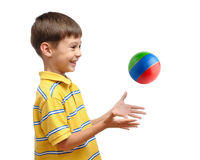 Child playing with colorful toy rubber ball. Isolated on white background Stock Photo