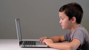 Child playing on the computer and phone at home stock footage