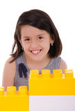 Child playing with construction blocks Stock Images