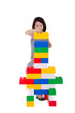 Child playing with construction blocks Stock Photos
