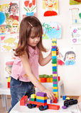 Child playing construction set in play room. Royalty Free Stock Photography