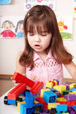 Child playing construction set in play room. Royalty Free Stock Photo