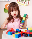 Child playing construction set in play room. Stock Photography