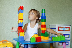 Child playing with constructor Stock Photo