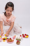 Child Playing Cooking Toy Set / Child Playing Cooking Toy Set Ba. Happy little girl is playing with her cooking toy set Stock Photos