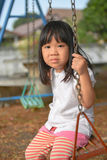 Child playing. Cute litter girl playing at the playground Royalty Free Stock Photography