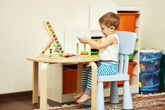 Father playing with child in developing game. Child playing in developing game at the table at home Stock Images