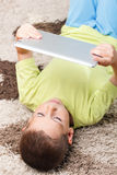 Child playing with digital tablet Royalty Free Stock Photo