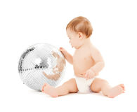 Child playing with disco ball Royalty Free Stock Photos