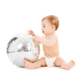 Child playing with disco ball Stock Image