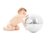 Child playing with disco ball Royalty Free Stock Images