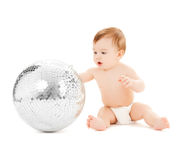 Child playing with disco ball Royalty Free Stock Image