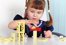 Child playing with dominoes Stock Photography