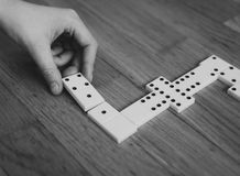 Child playing dominoes on the floor. Royalty Free Stock Photos