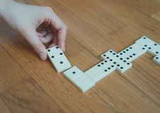 Child playing dominoes on the floor. Stock Images