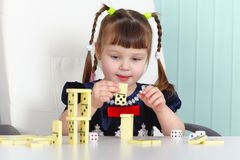 Child playing with dominoes at table Royalty Free Stock Photography
