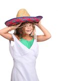 Child playing dressup. One young child putting on adult clothes playing dressup over white Stock Photography