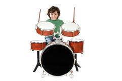 Child playing a drum. A over white background Royalty Free Stock Photography