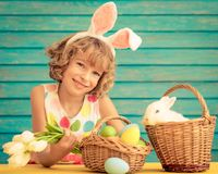 Child playing with Easter bunny. Child and Easter bunny. Kid playing with rabbit and eggs. Spring holidays concept royalty free stock photo